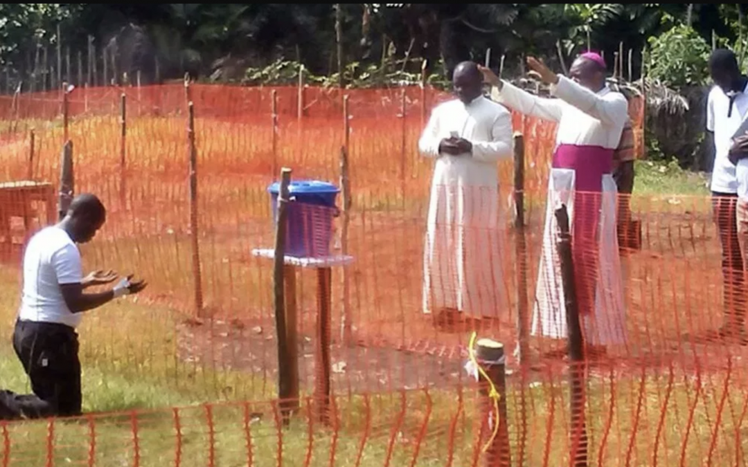Vincentian Ebola Victim receiving Archbishop's blessing